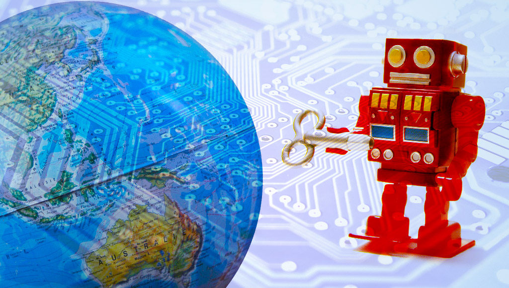 World globe with a toy robot and circuit board