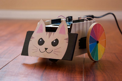 An Arduino kittybot with rainbow coloured wheels