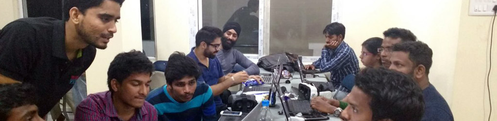 Ram Dayal Vaishnav assisting a group of developers