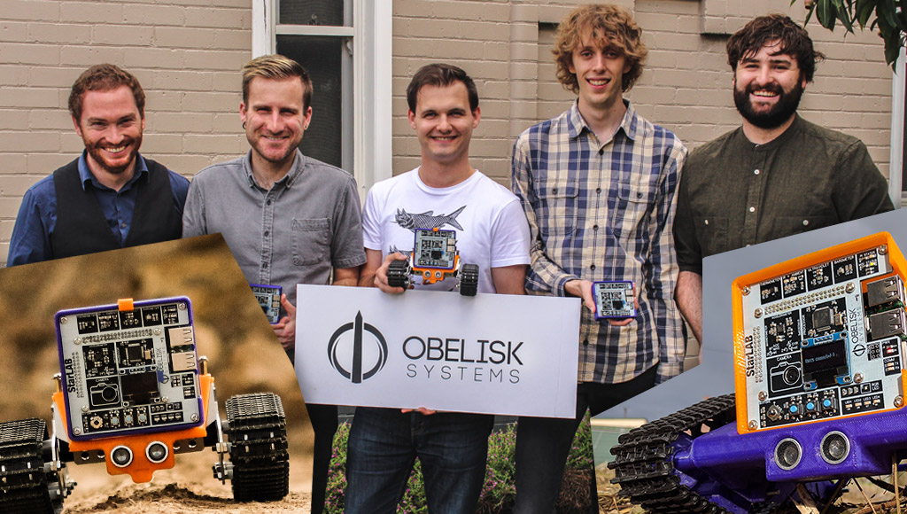 The Obelisk Systems team with StarLAB kits and rovers