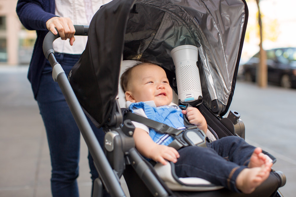 A baby in a stroller with a Wynd device